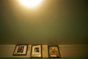 Shannon Taggart, Wall of Retired Mediums, 2003, C-Print, 21 x 30 inches, Courtesy of the artist