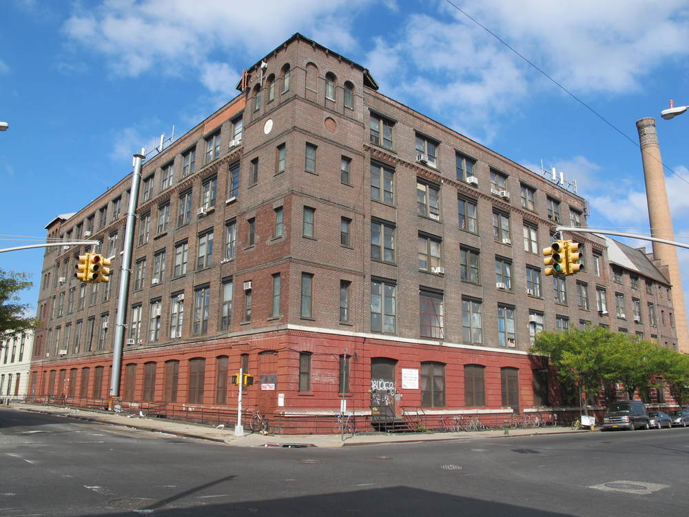 1027 Grand Street where Powhida currently rents a studio that is still below $2 a square foot in the East Williamsburg Industrial Zone. The building also houses the International Studio and Curatorial Program.