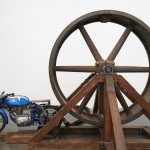 Chris Burden The Big Wheel, 1979 Three-ton, eight-foot diameter, cast-iron flywheel powered by a 1968 Benelli 250cc motorcycle 112 × 175 × 143 in (284.5 × 444.5 × 363.2 cm) The Museum of Contemporary Art, Los Angeles Gift of Lannan Foundation Photo: Benoit Pailley. Courtesy New Museum, New York.