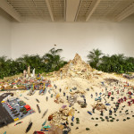 Chris Burden A Tale of Two Cities, 1981 Two miniature cities with approx.. five thousand toys, sand, plants, boulders 800—1,200 sq ft (243.8—365.8 sq m) Weight: Approx. 53,000 lbs Orange County Museum of Art, Newport Beach Photo: Benoit Pailley. Courtesy New Museum, New York.