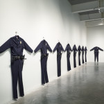 Chris Burden L.A.P.D. Uniforms, 1993 Wool serge, metal, leather, wood, plastic, Beretta handguns 88 × 72 × 6 in (223.5 × 182.8 × 15.2 cm) each Marion Boulton Stroud, Philadelphia, and Chris Burden in collaboration with the Fabric Workshop and Museum, Philadelphia Photo: Benoit Pailley. Courtesy New Museum, New York.