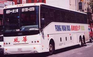 Chinatown buses line Canal in NYC.