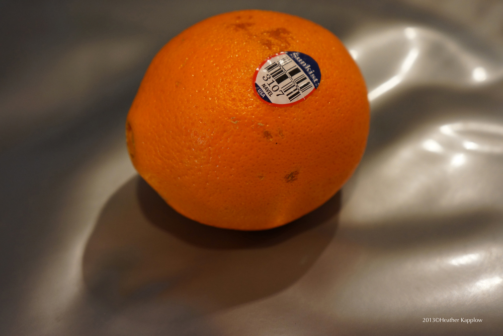 Photo of the orange described by the author of this article, taken during the time of the article's writing. Copyright 2013 Heather Kapplow.