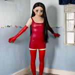 Laurie Simmons, Brunette/Red Dress/Standing Corner, 2014.  Courtesy of the artist and Salon 94.