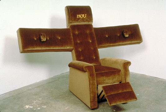 Christopher Chiappa, Lazy Boy Crucifix, 1999, upholstered chair: 36 x 60 x 48 inches. Courtesy of Fredericks Freiser Gallery, New York.
