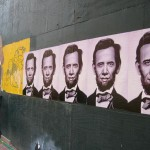Poster versions of Abraham Obama hung in the South End, alongside a piece by Geoff Hargadon.