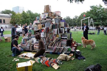 Zhang Huan, My Boston, performance with book pyramid and dogs, 2005