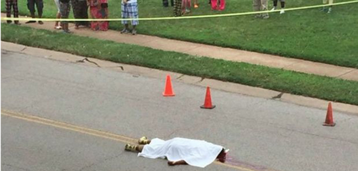 Covered body of Michael Brown, Ferguson, MO Photo courtesy of Tiffany Mitchell