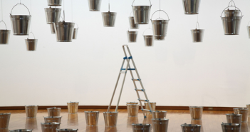Rivane Neuenschwander, Rain Rains, 2002. Aluminum buckets, water, steel cable, ladder, dimensions variable. Installation view, Hiroshima City Museum of Contemporary Art, Hiroshima.