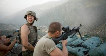 Specialist Misha Pemble-Belkin (l.) and fellow soldiers from Battle Company, 173rd US Airborne during a firefight at Outpost Restrepo during combat in Afghanistan's Korengal Valley. Korengal Valley, Afghanistan, Kunar Province. 2008. A film still from the documentary RESTREPO by Tim Hetherington and Sebastian Junger. Photograph © Tim Hetherington