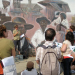 Marie Cieri, discussing African-American Boston in front of a mural in Dudley Square.