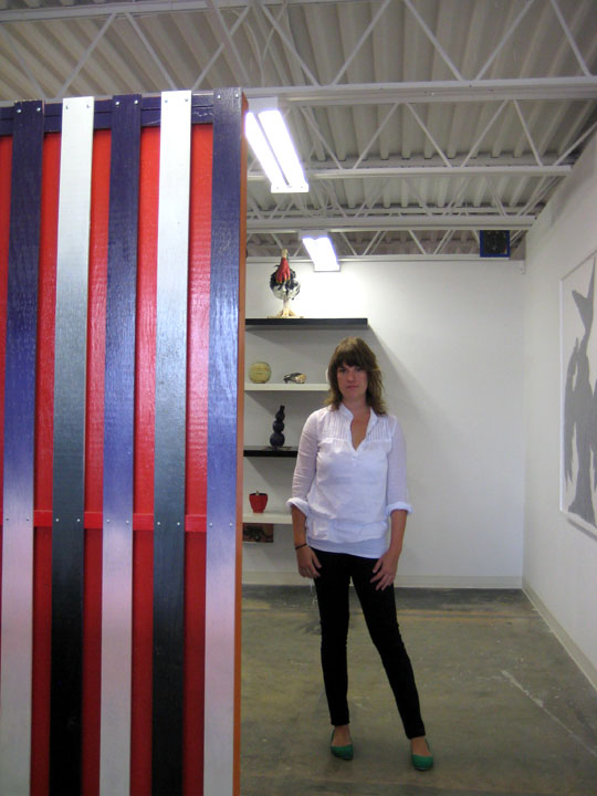 Emily Isenberg in LaMontagne Gallery with a piece by Jacques Louis Vidal.