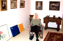 Jane Hudson with her exhibition at North Adams Antiques.