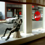 A sculpture by Eric Rudd surveys the passing scene on Eagle Street.