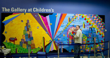 Neelon at work on the Imagination Wall at Children's Hospital in September 2009. (image credit: Christian Holland)