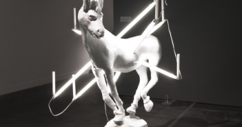 Joshua Webb, SOMEWHERE BETWEEN: Disco Donkey on Fire & Do Donkeys Bleed Blue Blood in Space, Styrofoam, plaster, epoxy resin, fluorescent lights, Karl Marx's severed head, candles extinguished by institutional policy, 2010.