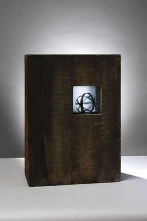 Steve Hollinger, Atomic #2, glass plates, polarizing film, solar mechanism, wooden box, 2006.