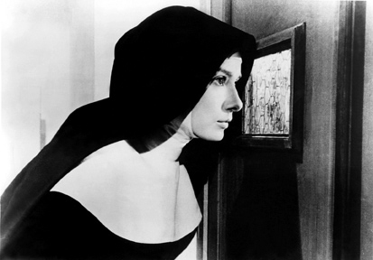 Publicity photo of piqued curiosity: Audrey Hepburn as Sister Luke in The Nun's Story, 1959.