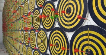 Jacob Dahlgren, I, the world, things, life, installation of a wall of dartboards, 2004.