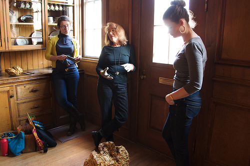 Jessie, Jill Slosburg-Ackerman's assistant, Slosburg-Ackerman and curator Meg Rotzel discuss what to do with IMPORT-EXPORT remains.
