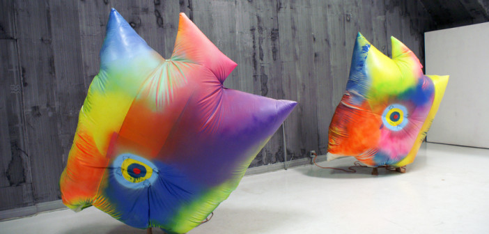 Claire Ashley, DOUBLE DISCO, Two performers, spray paint on PVC coated canvas tarpaulin, blower fans, and backpacks, 2012. Rehearsal still, Defibrillator Performance Space Chicago, IL Courtesy of the artist.