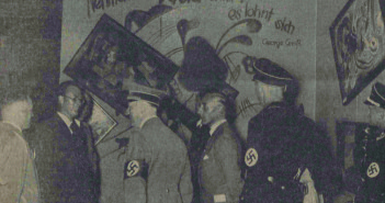"Adolf Hitler and other Nazi officials (Hoffmann, Willrich, Hansen, and Ziegler) standing by the Dada wall at the ""Entartete Kunst"" (Degenerate Art) exhibition, July 16, 1937. Paintings by Vasily Kandinsky, Paul Klee, and Kurt Schwitters have been deliberately hung askew and are accompanied by a slogan penned by George Grosz. This photo was published in the Nationalist Observer, South German (Süddeutsche) issue, No. 199, July 18, 1937. Staatsbibliothek zu Berlin Stiftung Preussischer Kulturbesitz, Berlin, Germany. bpk, Berlin, Art Resource, NY"