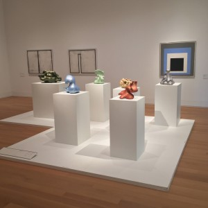 Six ceramic works by Kenneth Price at foreground, Joseph Albers Homage to the Square at rear.
