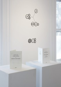 "Sarah Hulsey, ""Excerpts from A New System of Chemical Philosophy"" and ""On the Diagramming of English Words"" (pedestals: left to right); Oxygen, Zinc (wall: top to bottom), installation view, Schemata, Chandler Gallery, Maud Morgan Art Center, 2016."