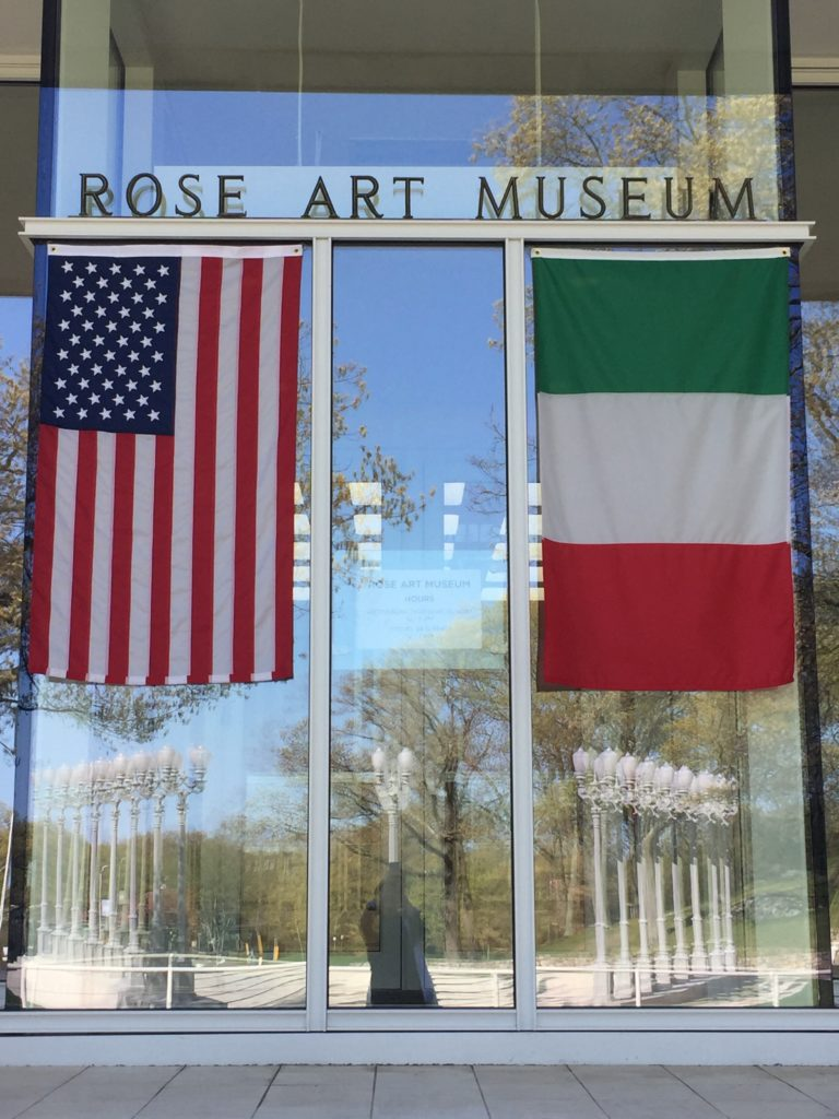 The Rose Art Museum exterior with American and Italian flags. Photo by Sam Toabe.