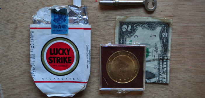 """""""First pack of cigarettes (one left), skeleton key, two dollar bill, Apollo landing coin."""" Image by Caitlin Duennebier."""