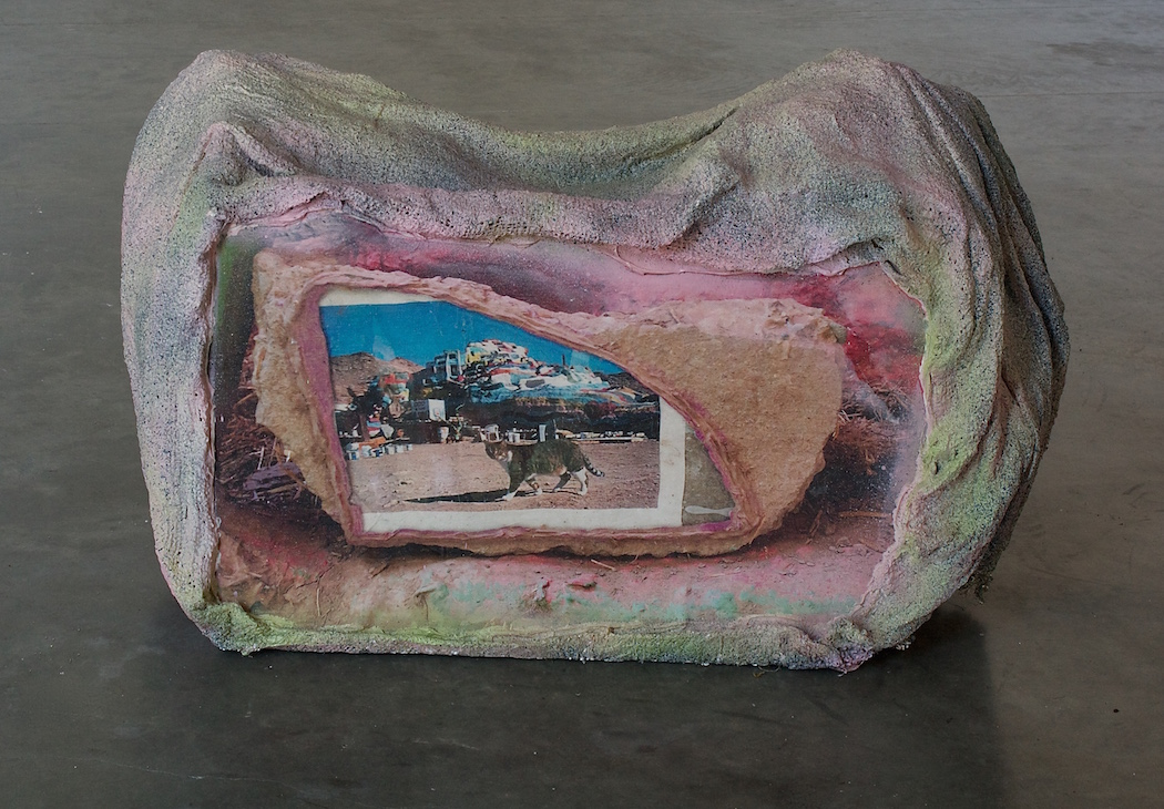 Audrey Hope, Kitty Rock III, photograph printed on canvas, plaster soaked burlap, caulk, spray paint, wood and wire frame, 30 x 18 x 20 inches, 2016.