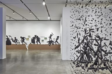 Installation view, First Light: A Decade of Collecting at the ICA, The Institute of Contemporary Art/Boston, 2016-17. Photo by Charles Mayer Photography. Kara Walker, The Nigger Huck Finn Pursues Happiness Beyond the Narrow Constraints of your Overdetermined Thesis on Freedom - Drawn and Quartered by Mister Kara Walkerberry, with Condolences to The Authors, 2010. The Barbara Lee Collection of Art by Women. Courtesy the artist and Sikkema Jenkins & Co. ©2016 Kara Walker. Cornelia Parker, Hanging Fire (Suspected Arson), 1999. Gift of Barbara Lee, The Barbara Lee Collection of Art by Women ©2016 Cornelia Parker.
