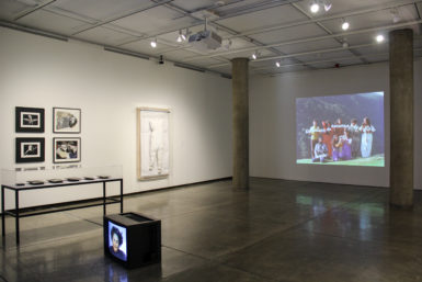 Installation view, Embodied Absence: Chilean Art of the 1970s Now, Carpenter Center for the Visual Arts, Sert Gallery, Oct 27, 2016–Jan 8, 2017. Floor: Carlos Leppe, Las Cantatrices, 1979. Left: Francisco Copello, Il Gioco dell´Ambiguita (The Ambiguity Game), 1977. Center: Catalina Parra, Imbunche gigante (Giant Imbunche), 2016. Right: Cecilia Vicuña, Sol y Dar y Dad, una palabra bailada, a danced word, 1980. Courtesy Carpenter Center for the Visual Arts, Harvard University.