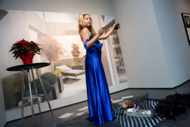 """Dell Hamilton at her in-gallery performance in response to the Cooper Gallery's """"Carrie Mae Weems: I once knew a girl…"""" exhibition on December 22, 2016. Photo credit: Melissa Blackall."""
