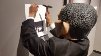 """Dell Hamilton, """"I Question America, I Question Us,"""" performance at the Photographic Resource Center, Photo credit: Bruce Myren."""