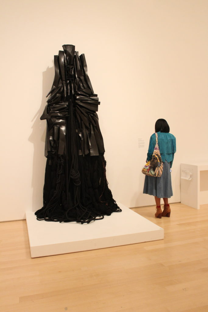 "One of the visitors sized up beside Barbara Chase Riboud's ""Confessions for Myself"". Photocredit: Chanel Thervil"
