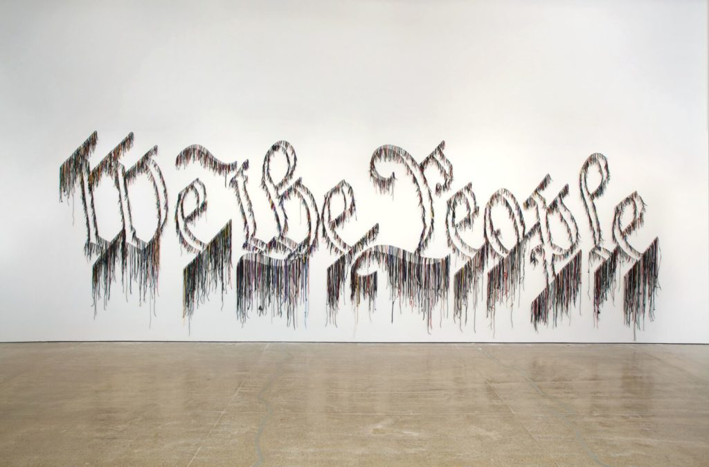 Nari Ward, We the People, 2011. Shoelaces, 96 x 324 inches (243.8 × 594.4 cm). In collaboration with the Fabric Workshop and Museum, Philadelphia. Courtesy the artist and Lehmann Maupin, New York and Hong Kong. Photo by Will Brown, image courtesy the artist, Lehmann Maupin, New York and Hong Kong, and the Fabric Workshop and Museum, Philadelphia© 2017 Nari Ward
